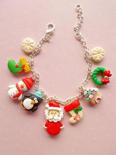 Christmas charm bracelet with Santa and his friends. A cute gift idea for Christmas or Secret Santa. The lenght of the bracelet is 21 cm and it is fully adjustable by switching to one link to another. Each charm measure between 1 and 1.8 cm. The bracelet is created form polymer clay without using molds or forms.  ❀ Because i make everything by hand, the item you receive may differ slightly than shown on the pictures.  ❀ Price is for one full bracelet.  ❀ I ship the orders very quickly, in 1…