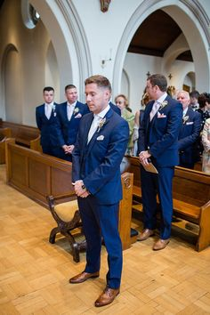 Groom wears a three piece blue suit | Photography by http://www.johastingsphotography.co.uk/