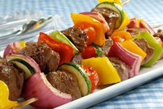 Heat pan with 2 tablespoons of olive oil and put skewers on it, turning every 5 minutes. Cook for 15 minutes and serve.