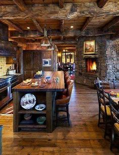 I surprisingly like this kitchen, maybe because of the fireplace and all the wood.