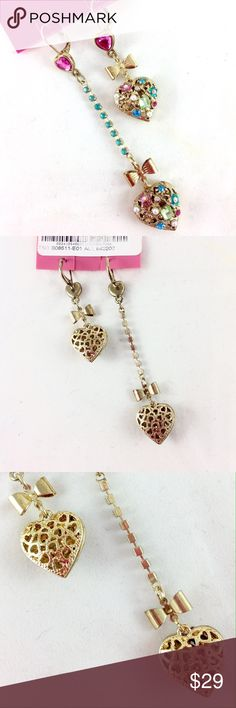"""Betsey Johnson Asymmetrical Heart Earrings NWT Brand new with tags. Authentic. Purchased at Dillard's. Betsey Johnson asymmetrical dangle Heart and bow earrings with colorful stones. 3"""" and 2"""" long.  Beautiful details on back, also.      Ask all questions before you purchase! I'm happy to help! No trades or holds. Bundle for best prices or ask for a custom bundle! Betsey Johnson Jewelry Earrings"""