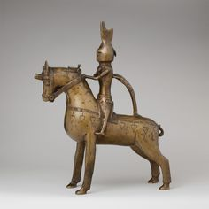 In modern usage, an aquamanile is a ewer or jug-type vessel in the form of one or more animal or human figures. It usually contained water for the washing of hands (aqua + manos) over a basin, which was part of both upper-class meals and the Christian Eucharist.