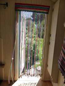 In my last post I left you with an unidentified pic as to what was on my hook as my next cheap and cheerful summer-living project. Well, here it is: A crochet fly-curtain! And just as the weather tur Crochet Curtain Pattern, Crochet Curtains, Beaded Curtains, Curtain Patterns, Crochet Patterns, Fabric Strip Curtains, Door Curtains, Fabric Strips, Valance