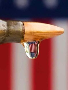 This is a bullet with a drip of water with the American flag in it. Sometimes, Americans feel in order to establish justice, they need to use guns..