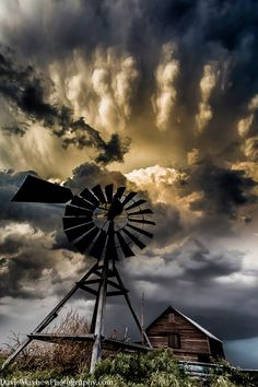 Needs a title! Old barn and windmill with a supercell at sunset from Eastern Colorado.
