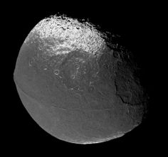 "Saturn's moon Iapetus. Discovered by Giovanni Cassini in 1671. It looks as if the moon is in shadow on the right hand side, but that is actually the dividing line between a bright hemisphere and one which is as dark as coal. (Photo: Images by Cassini probe 2004-12-31, Mosaic by Matt McIrvin) ©Mona Evans, ""10 Amazing Facts about Saturn's Moons"" http://www.bellaonline.com/articles/art28136.asp"