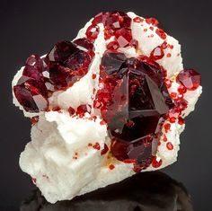 Exceptional specimen featuring a large Spessartine Garnet | Geology IN                                                                                                                                                                                 More
