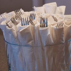 I like this idea - wrapping utensils in napkins for entertaining large groups