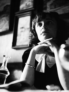 Edith Piaf in a Parisian cafe, c. 1930's
