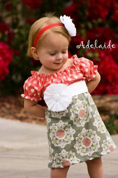 Use the Polly Peasant dress pattern, dress it up similar to this.