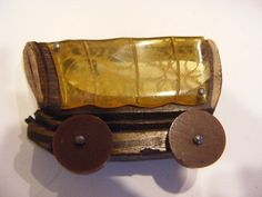 Vintage Carved Apple Juice BAKELITE Wood Covered WAGON PIN BROOCH Moving Wheels