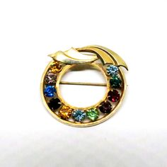 Jewel Tone Brooch - Vintage, Catamore Signed, 12K Gold Filled, Multi-Colored Rhinestones, Circular Pin by MyDellaWear on Etsy $24