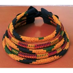 A vibrant colored 5 strand necklace made from African wax print 100% Cotton Fabric and Nylon cord.  Perfect for your style and personality.