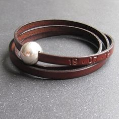 Personalised leather wrap cuff.