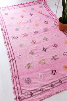 VINTAGE MOROCCAN KILIM RUG // THE LENA  handwoven from desert cactus silk called sabra, the lena features a modern geo pattern on a faded, pink