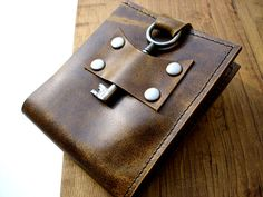 Steampunk bi-fold leather wallet with antique key