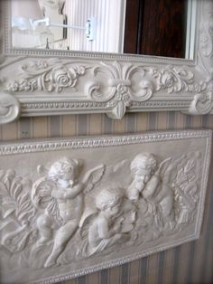 cherubs...I have a plaque similar to this. Maybe I'll paint it white.