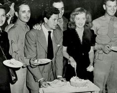 John Garfield and Bette Davis at the Hollywood Canteen.