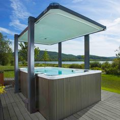 The Hot Tub and Swim Spa Company are one of the only multiple UK and European award-winning swim spa, hot tub, swimming pool, and wellness companies. Pool Spa, Spa Tub, Bathroom Spa, Backyard Pool Designs, Pool Landscaping, Backyard Pools, Pool Decks, Traditional Hot Tubs, Gardens