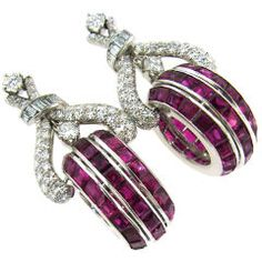 French cut Ruby, Diamond & Platinum Earrings Stunning and dressy earrings created in Europe in the 1960's. . The earrings are made of platinum and set with round brilliant, single and baguette cuts diamonds and natural French cut rubies.