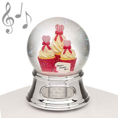 "Musical Water Globe - Mom and Cupcakes - A musical water globe is a gift that is sure to be treasured. This water globe features three delicious looking cupcakes and a message for Mom. The music that plays is ""Wind Beneath My Wings"" Mom will love it!"