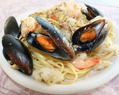 What's Cookin' Italian Style Cuisine: Seafood Medley Over Linguine With White Clam Sauce