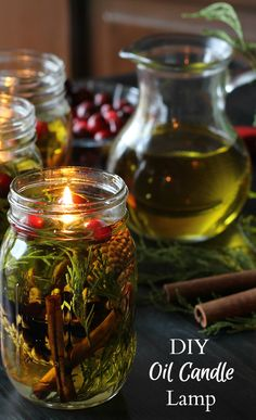 These beautiful candle lamps are made with olive oil, spices and essential oils…. These beautiful candle lamps are made with olive oil, spices and essential oils. Housed in mason jars, they will make a great gift for any one your list. Pot Mason Diy, Mason Jar Gifts, Mason Jar Candles, Candle Gifts, Diy Candle Lamp, Diy Candle Oil, Crafts With Mason Jars, Mason Jar Lamp, Homemade Candles