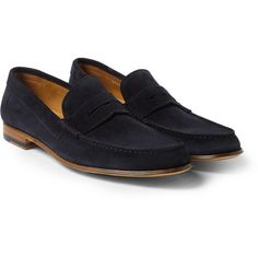 Italian-made Paul Smith penny loafers. The classic navy-blue suede uppers are incredibly soft, while the leather soles are crafted using Blake construction for flexibility.