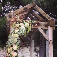 """Blush wedding by the raging Gallatin River in Big Sky MT . This rustic barn inspired wedding arch with a willow armature to a support a vine of vintage inspired flowers . The combination of blush roses , hydrangea ice with baby breath and lisianthus . Creating this truly romantic stop to exchange vows . #avantfloral is based out of Bozeman MT .  Say """"I Do"""" in Montana!"""