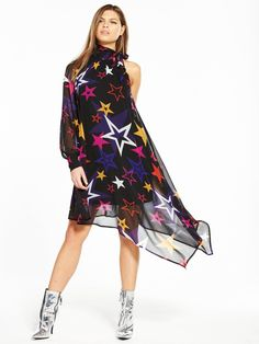V by Very Unique One Sleeve Asymmetric Star Print Dress This printed dress from V by Very Unique has got us all starry-eyed. High neckline, high hemline, high impact – it lends an interesting angle to your look with a one sleeve design and a graphic star print, which adds a pop of colour and Bowie-inspired cool.Styling Ideas Keep this piece in the spotlight by pairing with fuss-free heels and a small metallic clutch.