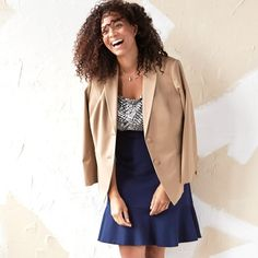 A borrowed-from-the-boys blazer over an A-line skirt, what's not to smile about?