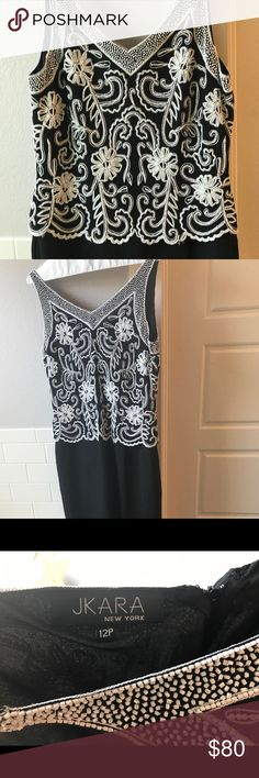 J Kara Beaded Dress--Mother of the Bride or Cruise This gorgeous dress is intricately beaded with white beads on a black bodice.  The bottom part of the dress is flowy and flattering with a slit in the back.  This would make a beautiful cruise dress or mother of the bride dress! J Kara Dresses Maxi