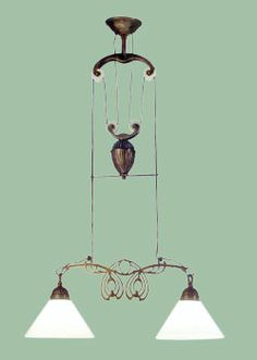 I have this over the kitchen sink and love it.  Loblolly General Goods : PULLEY LIGHT COLLECTION 2012