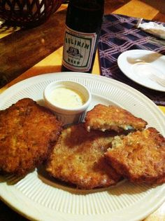Conch fritters & Belikin beer, Wendy's Restaurant, Placencia Belize. www.2sistersanytownusa.wordpress.com