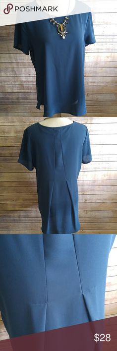 Deep jewel toned teal split back top My phone wouldn't capture the color but this is a dark teal.,so pretty. NWT. Polyester. Hangs lower in the back. Pleione Tops