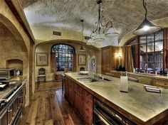 Rustic European Kitchen >> http://coolhouses.frontdoor.com/2013/02/11/winter-escape-scottsdale-estate-with-european-ambiance/?soc=pinterest#
