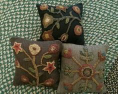 Primitive Hooked Pillows with Wool Background