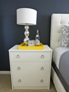 Use a serving tray to keep small items neatly corralled on a nightstand. http://www.hgtv.com/bedrooms/tips-for-a-clutter-free-bedroom-nightstand/pictures/page-5.html?soc=pinterest