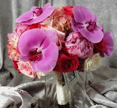 Mix rose bridal bouquet with phalaenopsis orchid. #wedding #roses #flowers #bride #bouquet