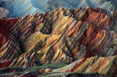 Zhangye Danxia Landform,  Gansu, China 甘肅 張掖 丹霞地貌 | The mountains are part of the Zhangye Danxia Landform Geological Park in China. Layers of different colored sandstone and minerals were pressed together over 24 million years and then buckled up by tectonic plates