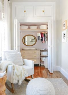 painting the inside of a closet pink via Yellow Brick Home   changing table in the closet   neutral nursery, white nursery, small nursery ideas, gender neutral nursery