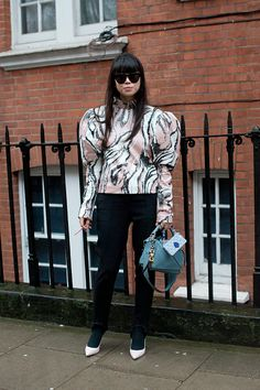 Fashion stylist Leaf Greener wears Stella McCartney trousers a JW Anderson top Sophia Webster shoes Loewe bag and AM Eyewear sunglasses on day 2...