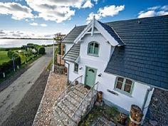 Strandhaus I Fehmarn auf Fehmarnsund: 2 Schlafzimmer, für bis zu 4 Personen. Liebevoll eingerichtetes Strandhaus mit Meerblick, in Südlage direkt am Strand   FeWo-direkt