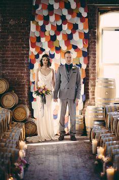 20 DIY Paper Wedding Backdrops via Brit + Co