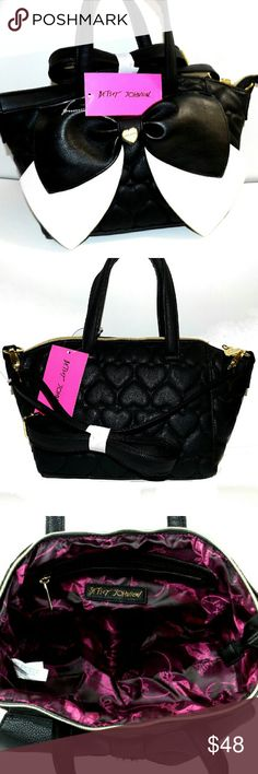 "BETSEY JOHNSON BowNanza MED Black & Bone SATCHEL Black and Bone Soft Quilted Hearts Leather Bag made of PCV. Comes with an adjustable (detachable) 23"" (drop) crossbody strap.  Features an oversized front two toned bow. Fully lined interior with 2 slip pockets and wall zippered pocket. Top zippered closure. Doubled handles with a 6"" drop. Dimensions 15"" (W) x 9"" (H) x 4.5"" (D) BRAND NEW WITH TAGS! Betsey Johnson Bags Crossbody Bags"