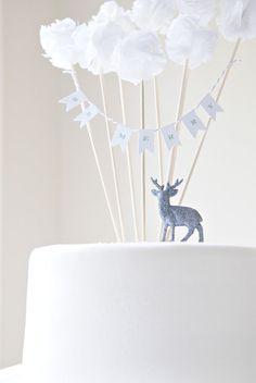 adorable deer, bunting, pompom cake decoration