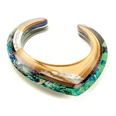 Jennifer Merchant Bracelet: Beveled Layered Acrylic Cuff 2013 Acrylic, magazine pages