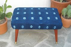 African Indigo Mudcloth Footstool with tapered mid century style legs by territoryhardgoods