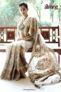This is a masterwork of fusion styles.....a khadi saree with paithani mtif and muga border..... very classy and quite sobre by usual Gaurang Shah standards