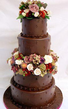 Dark chocolate ganache creates a striking finish for any dessert, even wedding cake!